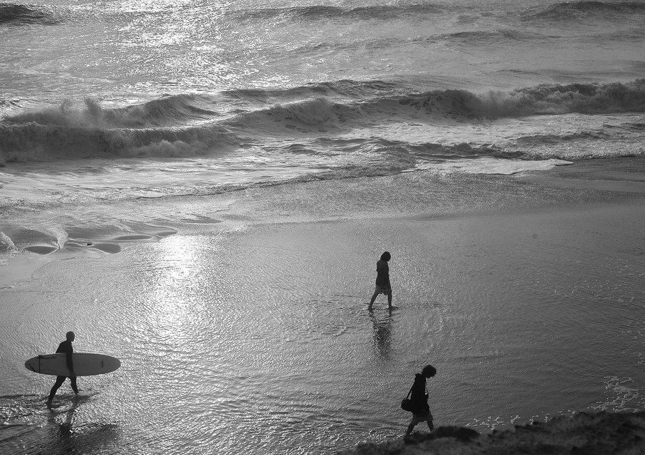 Surfers looking for a wave