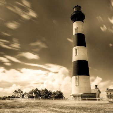 The Bodie Island Lighthouse near Pea Island in North Carolina.  Part of the Cape Hatteras National Seashore.  One of the bes things about shooting in the middle of the day is they make for great black and white pictures.
