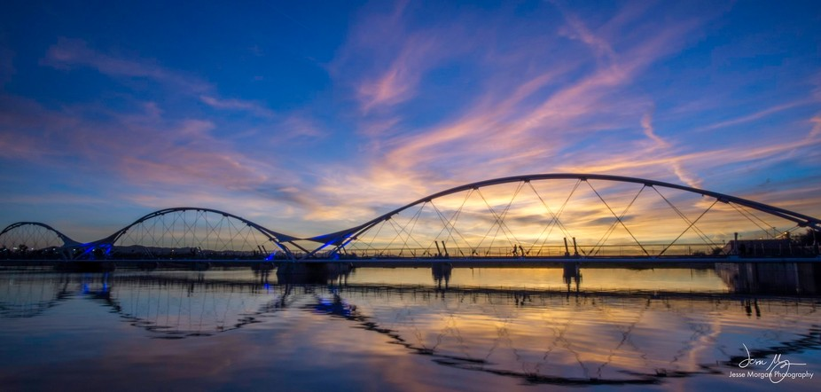 A wonderful sunset behind the iconic Elmore Bridge in Arizona
