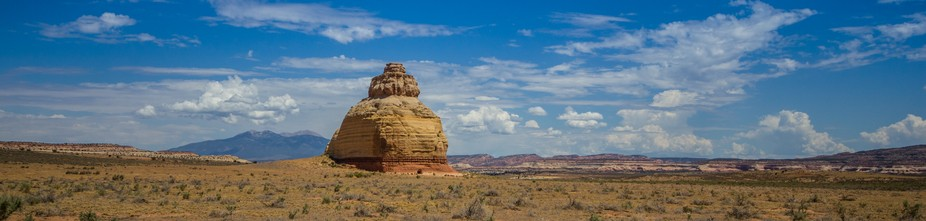 A famous natural rock formation in the flat plains of northern Arizona