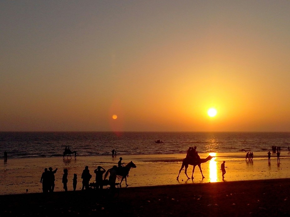 Visited mandvi, kutchh, India where people were enjoying the weekend at the beach while the sun w...