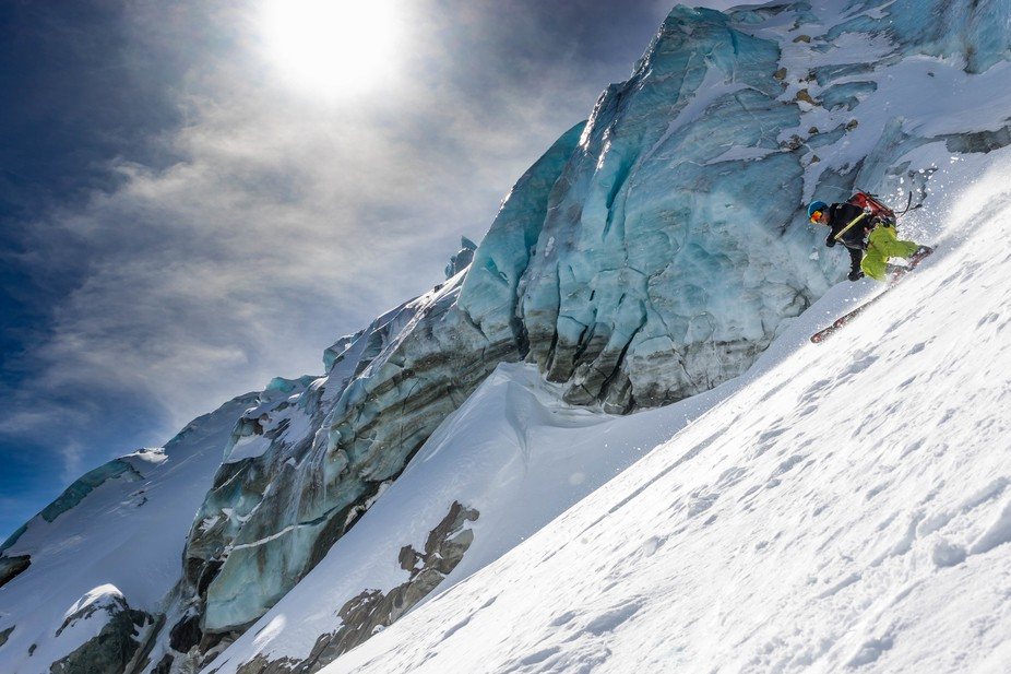 Roddy Anderson skiing past seracs on the Grand Envers in Chamonix.