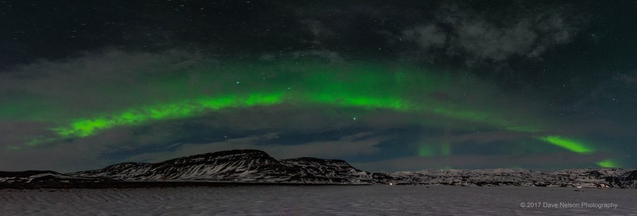 On the first night of my 7 day trip to Iceland, the aurora came out to play across the lower foot...