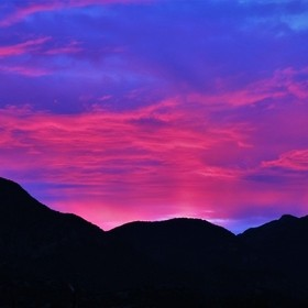 A rare Red Sky Sunset over the Huachuca Mountains of southeastern Arizona.