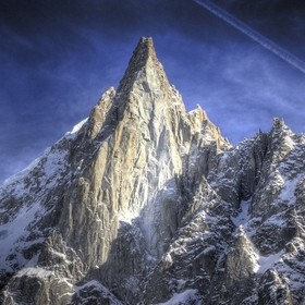 A 3 exposure HDR image of Les Drus, above Chamonix, France.  Shot on a Nikon D70, handheld with a Nikon 50-200 zoom.