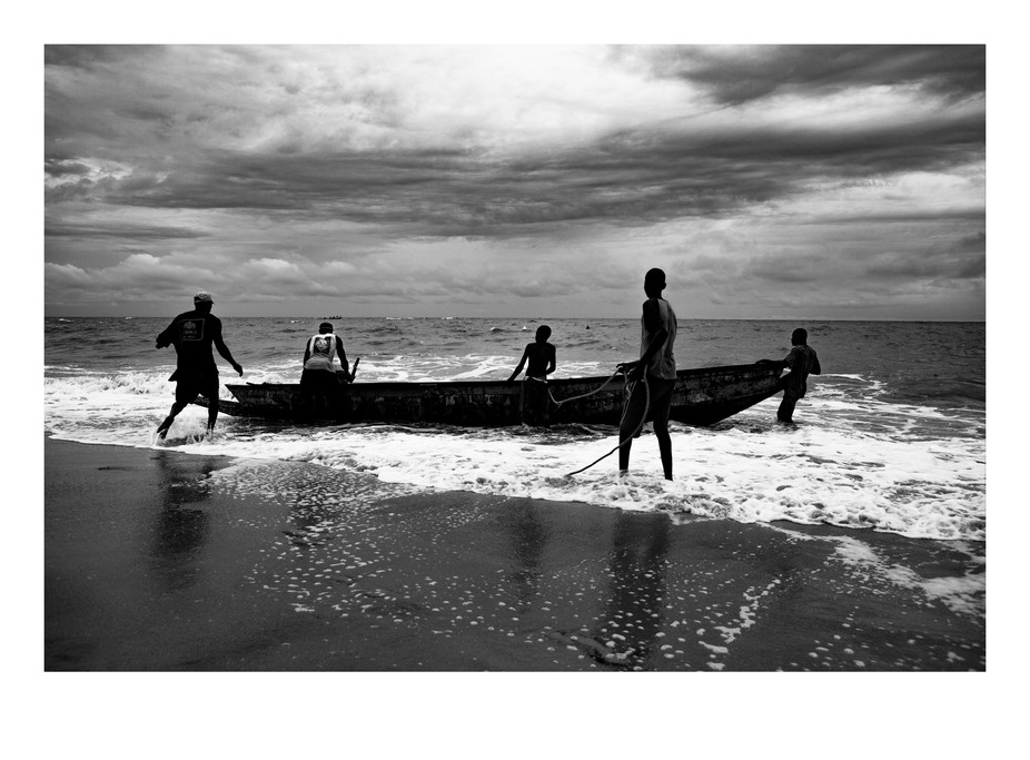 Local fishermen put their boat to sea for the days daily fishing on the coast of Senegal. Despite...