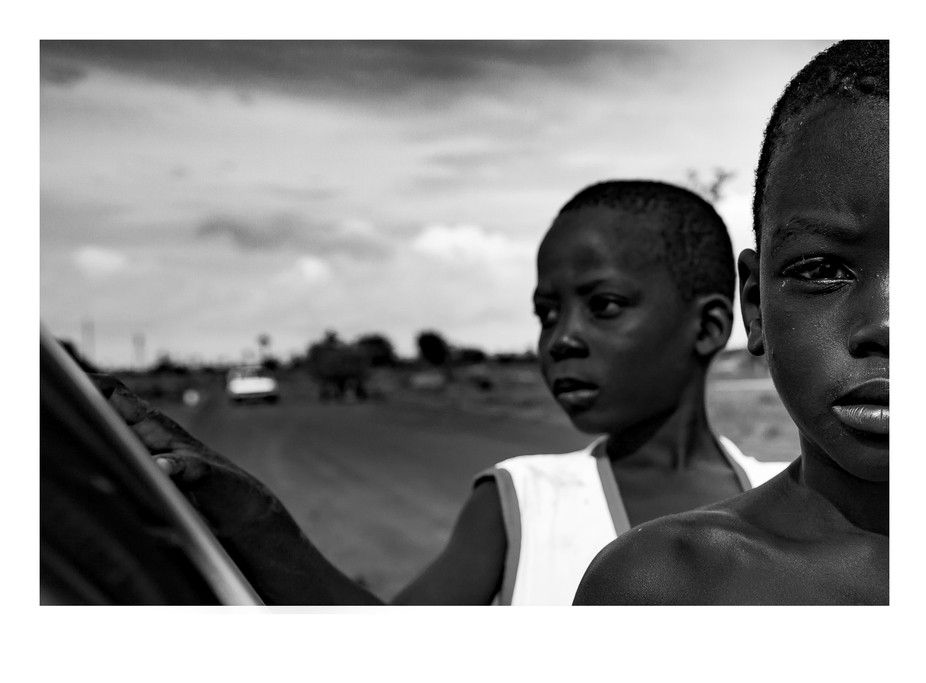 Stopped to stretch my legs by the side of the road after a long and hot day. Two young boys walke...
