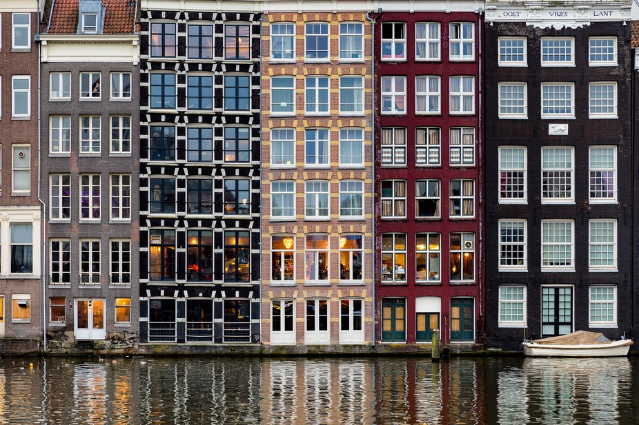 Windows of Amsterdam on the 404 year old canals of Amsterdam!  The historic urban ensemble of the...
