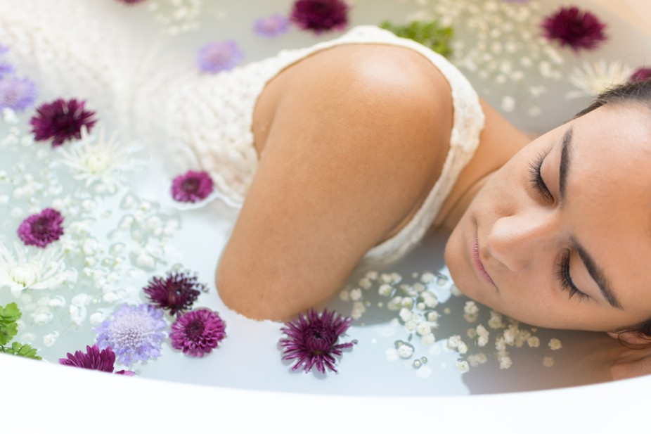 """This was a fashion / creative project with model in a """"milk bath"""" with flowers...."""