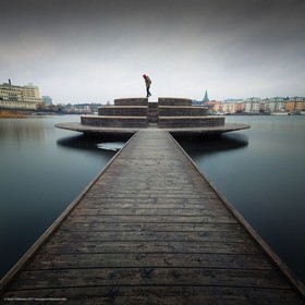 While looking for places to photograph on a cloudy day, I stopped by this jetty to take a self-portrait.