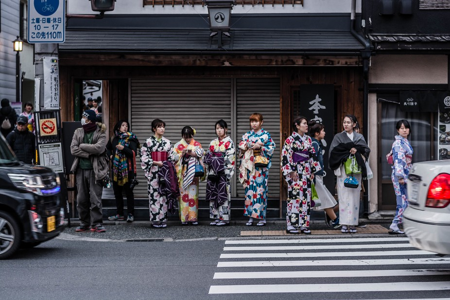 A cross walk in Kyoto during a spring festival.