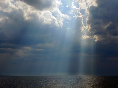 Before the storm. Rays of heavenly light. The shore of the Gulf of Finland, Kotlin island