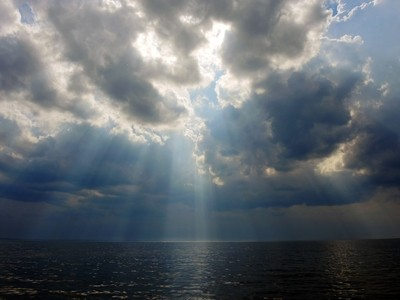 Rays of heavenly light. Before the storm. The shore of the Gulf of Finland, Kotlin island