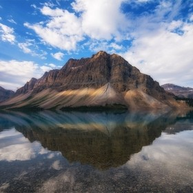 Breathtaking morning reflections on Bow Lake in Banff National Park on another day from my previous photo of this lake