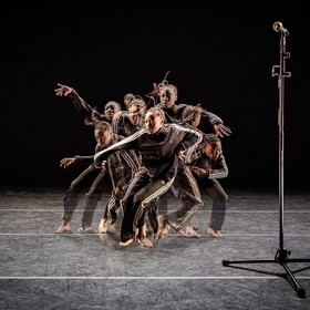 "This image is a composite of multiple shots from a live performance of choreographer Kyle Abraham's work, ""The Realest MC"". The ch..."