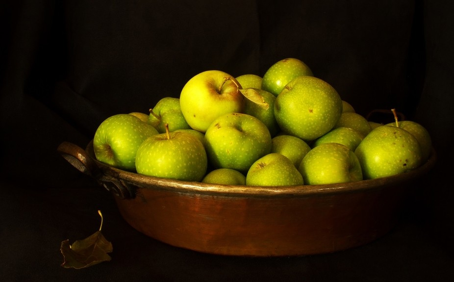 Apples from my garden in copper dish.  Only one apple has been polished.