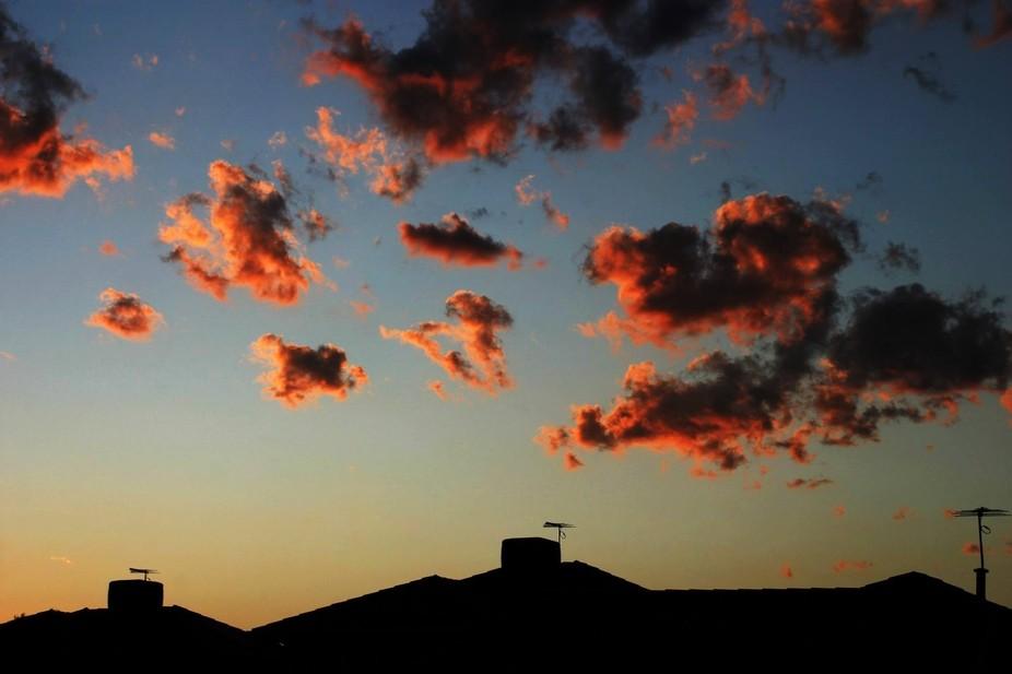 Sunset over suburbia by Brett Sixtysix.