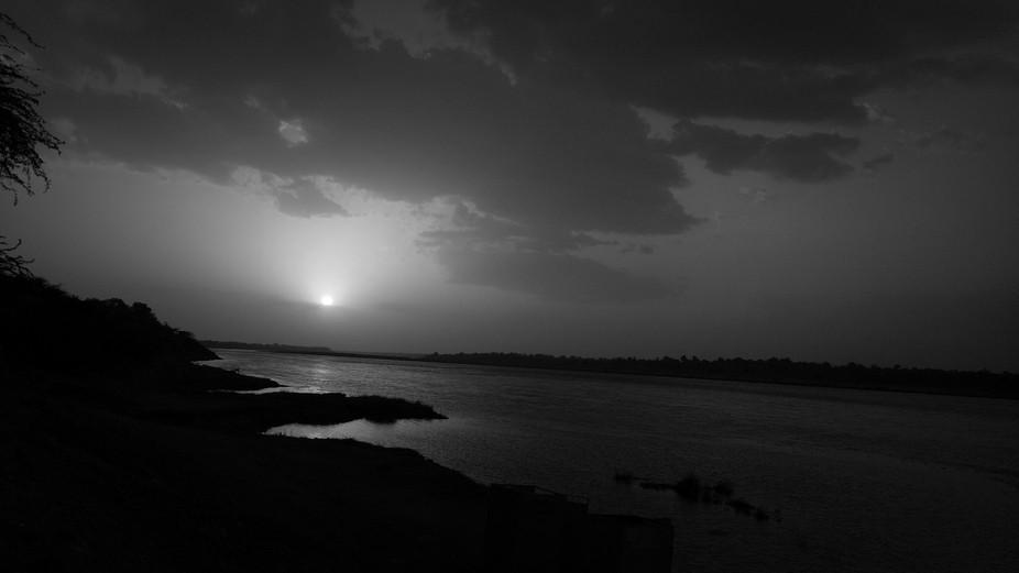 Sun set as  increasing flow of Water