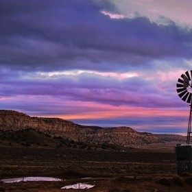 Pastel colors filled the sky during waning light on a chilly November evening.  This  windmill on sits on Navajo Reservation land in Northern New...