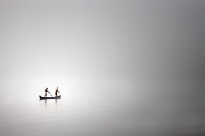 Fishing in a misty morning