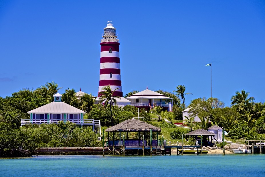 The famous Candy Striped Lighthouse found at the entrance to Hopetown Harbor on Elbow Cay located...