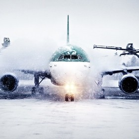 (C) Elmer Laahne 2017. www.laahne.com  Deicing of Airbus aircraft, at Oslo City Airport (OSL) during winter storm.