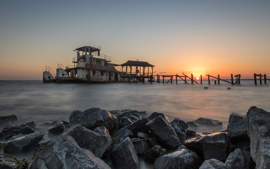 forgotten tugboat at sunset in Madisonville, Louisiana. 10 sec exposure, Olympus EM5 II. 12mm