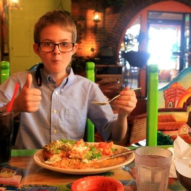 My son digging into his birthday lunch at a popular local restaurant.