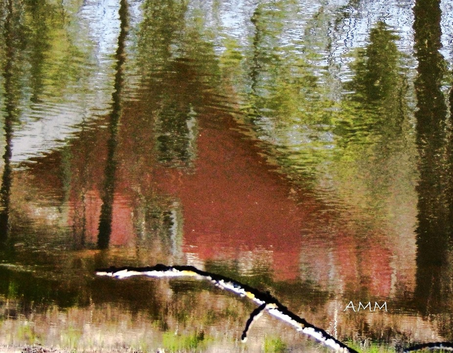 Little house reflected in stream.  Wakefield, Quebec, Canada.