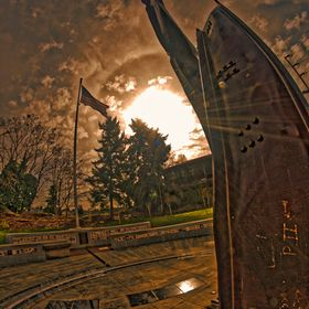 Morning sun beamed over the I-Beam  monument and the USA Flag at the 9-11 Memorial.  (Ronkinon 8mm F3.5)