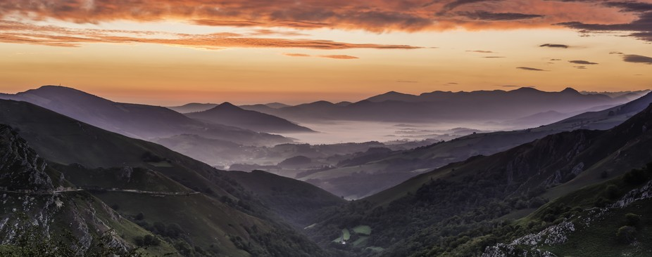 This is a 5-shot panorama taken at sunrise at the Baigorri Pass in Navarra, Spain. The view is Fr...