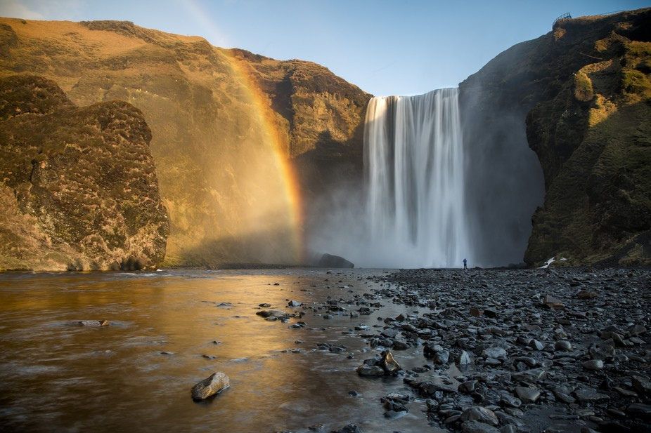 A rainbow as the sun crept over the horizon at Skogafoss on the Iceland southern coast