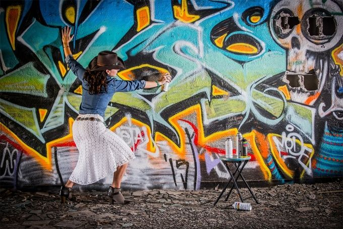 Country gilr takes on grafitti monster! by tmarinella - Creative Reality Photo Contest