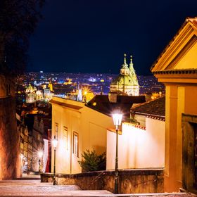 I witness Prague from end to end;  while far below  the dusk extend  its soundless steps through every lane.