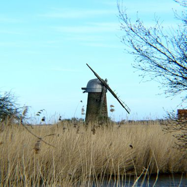 Derelict drainage Tower Mill along the River Thurne.
