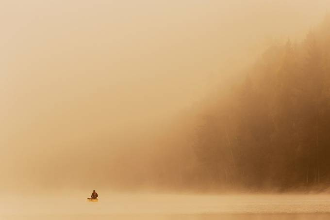 A man in a canoe during a misty autumn day by samirahkonen - Stillness Photo Contest