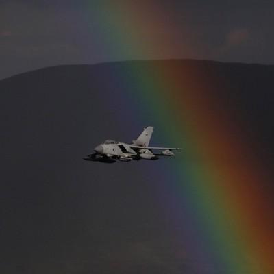 Tornado through a rainbow.