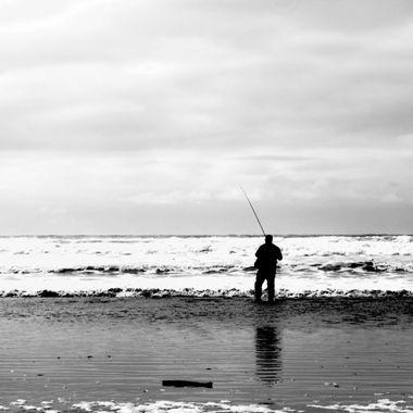 A Man Fishing in an Ocean