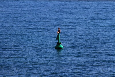 Man messing up with a buoy in Nice, France