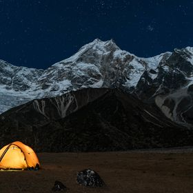 Camping under the stars and moonlight at the foot of Manaslu mountain.