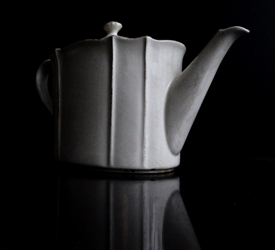 Black and white portrait of a teapot.