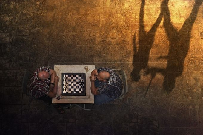 the next move by joecas - Opposites Photo Contest