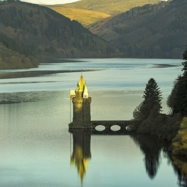 Early Morning light over Lake Vyrnwy showing the Straining Tower through which the water passes to remove material before its 70 mile journey to Liverpool,