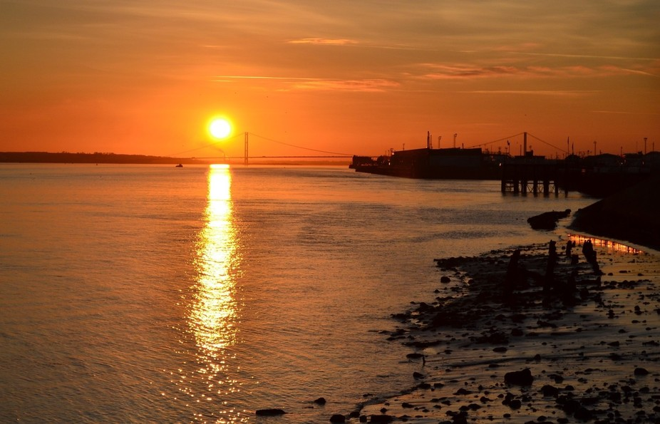 Sunset over the Humber Bridge and Victoria Pier, Hull, East Yorkshire UK. Taken from The Deep at ...