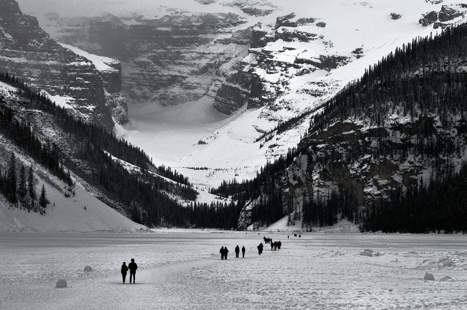It's early April. Lake Louise was frozen cold,it's not emerald blue summer lake...