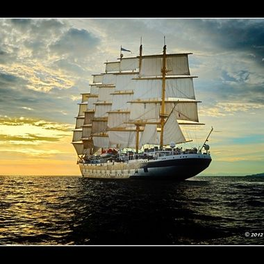 Royal Clipper Sailing ship under full sale on the Adriatic Sea    D700 with 17-35 f/2.8 zoom @ 30mm. f/9, 1/500, ISO 200. Processed in Capture NX2.Edit 8/8/17 reprocessed image in PSCS6 Extended using Picture Postcard workflow.   This was a difficult shot to make as the lens had no VR capability to damp out the up and down and swaying motion of the tender I was on circling the ship. That was compounded by the other passengers who were crowding the tender sides to get off their shots as well.