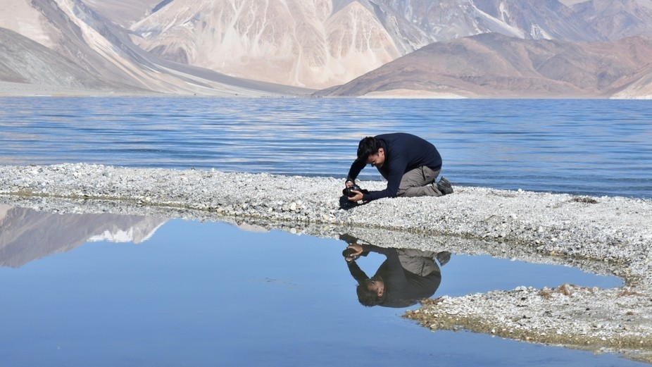 In a Landscape workshop at Ladakh, India, here is amateur photographer trying to capture somethin...