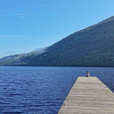 I took this photo when we were visiting Scotland in 2015.  We stopped at Loch Lomond and I took a photo of my daughter, Melodi as she was sitting near the lake.