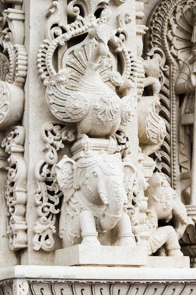 Peacock and elephant on exterior of BAPS Shri Swaaminaryan Mandir