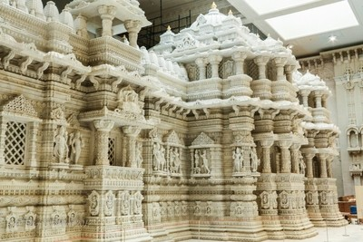 BAPS Shri Swaaminaryan Mandir is a temple within a building. The larger building is to protect the temple.